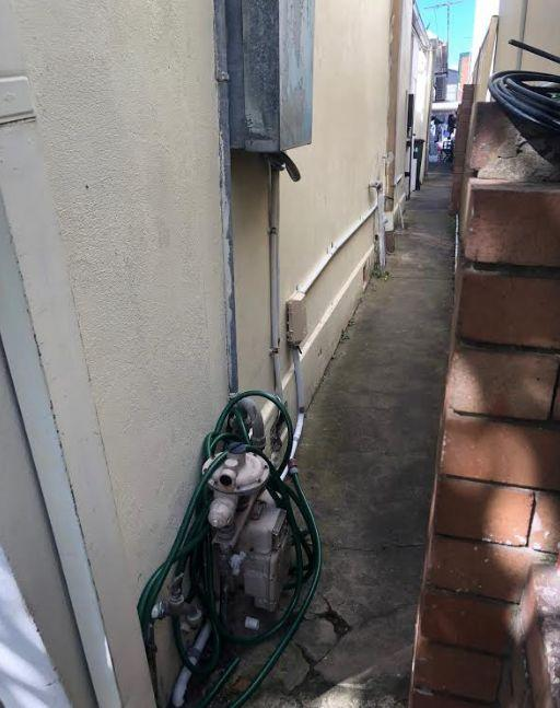 The alleyway where workers have been walking down to access the bathroom. Source: Supplied