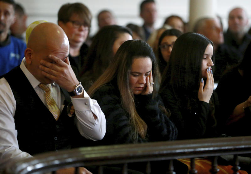Joevanny Vargas, Lorena Vargas and Madison Vargas grieve as witness impact statements are read regarding the death of Miranda Vargas during the sentencing of Hudy Muldrow, Wednesday, Feb., 26, 2020,  at state Superior Court in Morristown, N.J. Muldrow, 79, the driver of a school bus who veered across Interstate 80 in New Jersey after missing an exit and crashed into a dump truck, killing a teacher and a student and injuring dozens of others, was sentenced to 10 years in state prison. (Ed Murray/NJ Advance Media via AP, Pool)