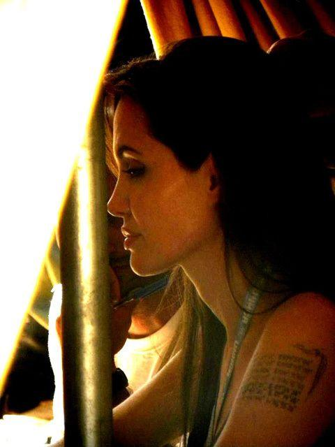 45a62f558 Angelina Jolie has added a new line of mapping co-ordinates to her existing  tattoo