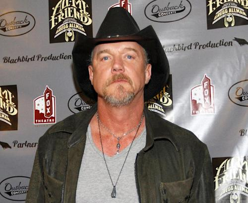 "FILE - This Jan. 10, 2014 file photo shows Trace Adkins at the All My Friends: Celebrating The Songs and Voice of Gregg Allman tribute in Atlanta. Adkins' publicist confirmed to The Associated Press on Wednesday, Jan. 15, 2014 that the singer entered rehab after consuming alcohol during the Country Cruising cruise. The 52-year-old ""Celebrity Apprentice"" winner has canceled the remainder of his performances during the weeklong cruise that wraps up Sunday after stops in Jamaica, Grand Cayman and Mexico. (Photo by Dan Harr/Invision/AP, FIle)"