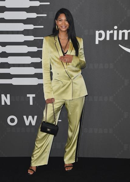Chanel Iman in a satin pantsuit embellished with black piping. New York, September 10, 2019