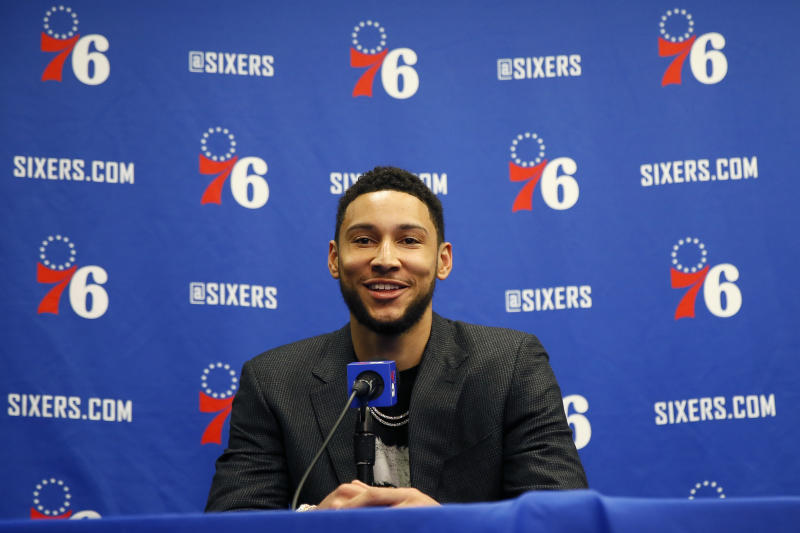 FILE - In this March 11, 2020, file photo, Philadelphia 76ers' Ben Simmons smiles while speaking at a news conference before an NBA basketball game against the Detroit Pistons in Philadelphia. Video games have become a go-to hobby for millions self-isolating around the world, and athletes from preps to pros have eagerly grabbed the controls. Stars like Ben Simmons and Luka Doncic have turned to gaming to stay connected with fans.(AP Photo/Matt Slocum, File)