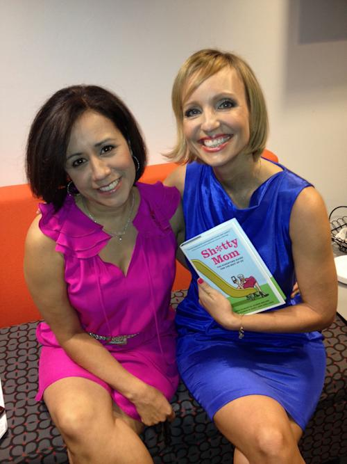"This Sept. 11, 2012 image released by Yfat Reiss Gendell shows Alicia Ybarbo, left, and Mary Ann Zoellner, two of four authors of ""Sh*tty Mom,"" posing with their book in New York. The latest in irreverent parenting books is part parody and part painful truth. It's written by four very busy, often tired working moms looking to offer some overdue LOLs as counterpoint to today's parenting-to-perfection mania. (AP Photo/Yfat Reiss Gendell)"
