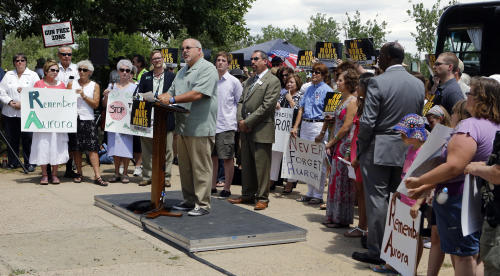 Tom Sullivan, whose son Alex Sullivan was killed on his 27th birthday in the Aurora theater shooting, speaks at a remembrance rally for the anniversary of the shooting at Cherry Creek State Park in Aurora, Colo., on Friday, July 19, 2013. Saturday, July 20, is the anniversary of the Aurora theater shootings. (AP Photo/Ed Andrieski)