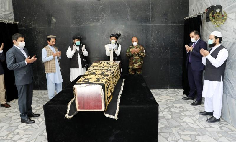 Afghanistan's President Ashraf Ghani prays over the coffin of Ayaz Niazi, a well-known scholar, who was killed last night by a bomb blast in Kabul
