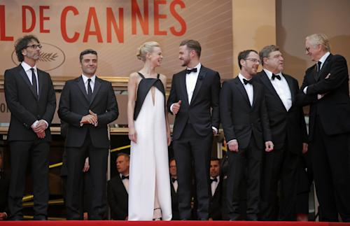 From left, director Joel Coen, actors Oscar Isaac, Carey Mulligan, Justin Timberlake, director Ethan Coen, actor John Goodman and musician T-Bone Burnett arrive for the screening of the film Inside Llewyn Davis at the 66th international film festival, in Cannes, southern France, Sunday, May 19, 2013. (AP Photo/Lionel Cironneau)