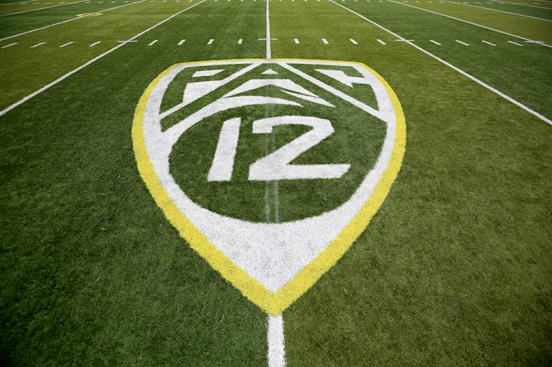 A PAC-12 logo is seen painted on the field before an NCAA college football game between Washington State and Oregon Saturday, Oct. 10, 2015, in Eugene, Ore. (AP Photo/Ryan Kang)