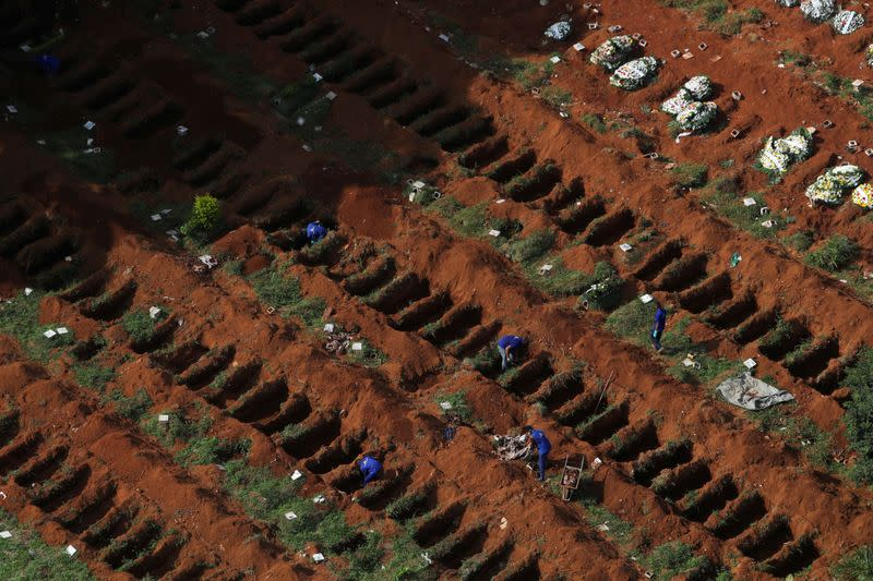 FILE PHOTO: Gravediggers open new graves as the number of dead rose after the coronavirus disease (COVID-19) outbreak, at Vila Formosa cemetery, Brazil's biggest cemetery, in Sao Paulo