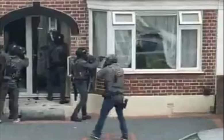Police at a property in East London