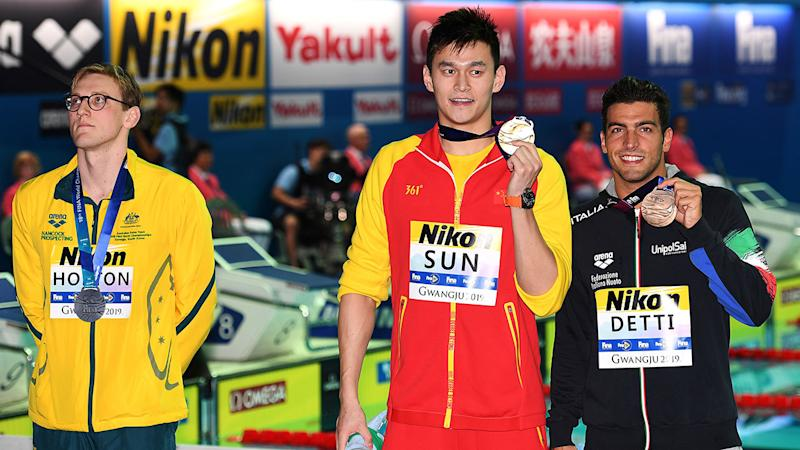 Mack Horton didn't stand next to Sun Yang for photos either. (Photo by OLI SCARFF/AFP/Getty Images)