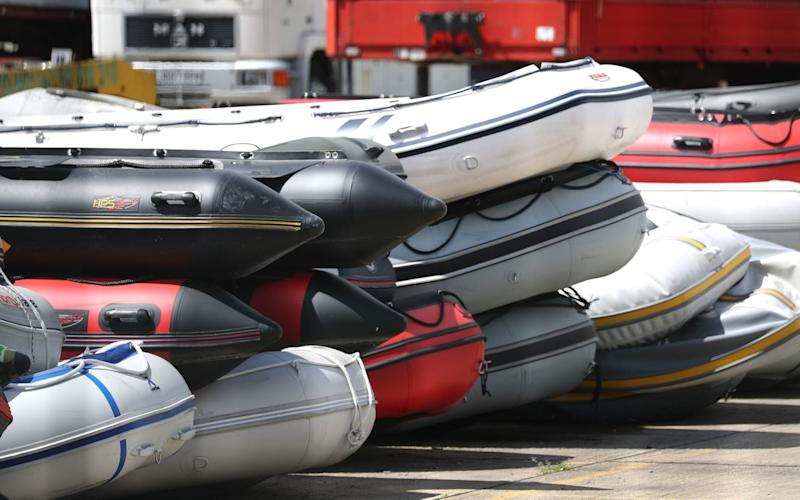 Seized boats in a compound in Dover - gareth fuller/pa