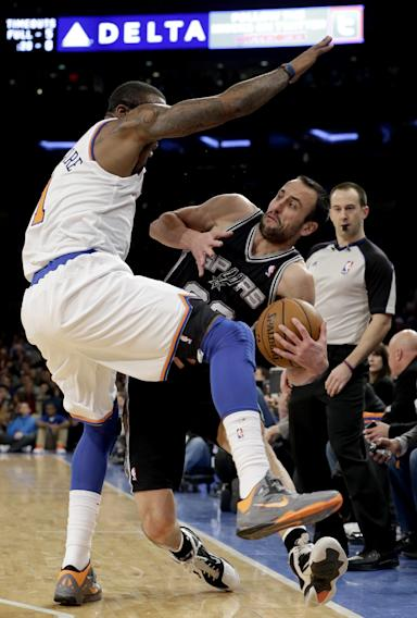 San Antonio Spurs guard Manu Ginobili (20) tries to stay in bounds as he passes around New York Knicks forward Amare Stoudemire (1) in the first half of their NBA basketball game at Madison Square Garden in New York, Thursday, Jan. 3, 2013. (AP Photo/Kathy Willens)