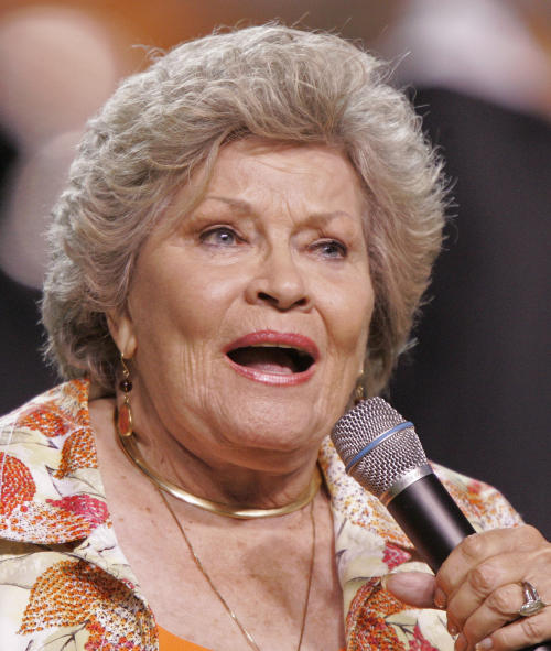 "FILE - In this Sept. 26, 2009 file photo, singer Patti Page performs the Tennessee Waltz during halftime of a NCAA college football game Tennessee and Ohio in Knoxville, Tenn. Page, who made ""Tennessee Waltz"" the third best-selling recording ever, has died. She was 85. (AP Photo/Wade Payne, file)"