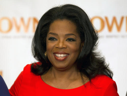 "FILE - This April 16, 2012 file photo shows Oprah Winfrey in Toronto. Winfrey and Arianna Huffington launched ""HuffPost OWN,"" a new section on the Huffington Post website on Thursday, Nov. 1, that will feature material from the Oprah Winfrey Network and Oprah.com. The new online destination will focus on lifestyle advice and personal inspiration. (AP Photo/The Canadian Press, Frank Gunn, file)"