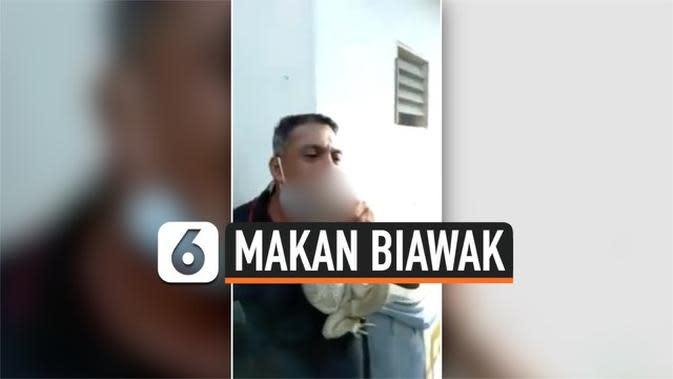 VIDEO: Demi Viral Pria Makan Biawak Hidup-Hidup