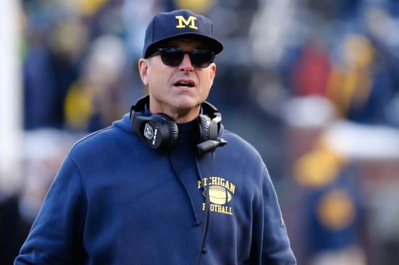 Michigan's Harbaugh prefers empty stadiums to no games