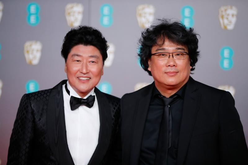 South Korean actor Song Kang Ho and South Korean director Bong Joon-ho pose on the red carpet upon arrival at the BAFTA British Academy Film Awards at the Royal Albert Hall in London on February 2, 2020. (Photo by Tolga AKMEN / AFP) (Photo by TOLGA AKMEN/AFP via Getty Images)