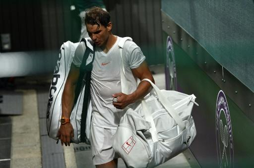 See you Saturday: Rafael Nadal leaves the court on Friday night