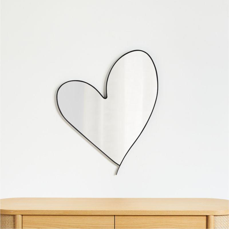 """<p><strong>crate and barrel</strong></p><p>crateandbarrel.com</p><p><strong>$149.00</strong></p><p><a href=""""https://go.redirectingat.com?id=74968X1596630&url=https%3A%2F%2Fwww.crateandbarrel.com%2Fheart-wall-mirror%2Fs644746&sref=https%3A%2F%2Fwww.countryliving.com%2Fshopping%2Fgifts%2Fg34112136%2Fleanne-ford-crate-and-barrel%2F"""" target=""""_blank"""">Shop Now</a></p><p>A mirror with a playful silhouette, great for the big kids and sweet enough for a little one's nursery. It would also look fun greeting you in your entryway! </p>"""
