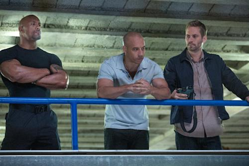 "This film publicity image released by Universal Pictures shows Dwayne Johnson , left, Vin Diesel, center, and Paul Walker in a scene from ""Fast & Furious 6."" (AP Photo/Universal Pictures, Giles Keyte)"