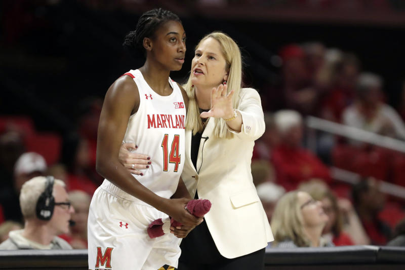 """FILE - In this Jan. 6, 2020, file photo, Maryland head coach Brenda Frese, right, talks with guard Diamond Miller during the second half of an NCAA college basketball game against Ohio State in College Park, Md. For all the wealth, privilege and rewards elite sports can provide its participants, few vocations require more time away from loved ones. """"I appreciate the gift of time and being able to spend it with my family,"""" said Maryland women's basketball coach Brenda Frese, whose fourth-ranked Terrapins might well have been in New Orleans last week for the Final Four. (AP Photo/Julio Cortez, File)"""