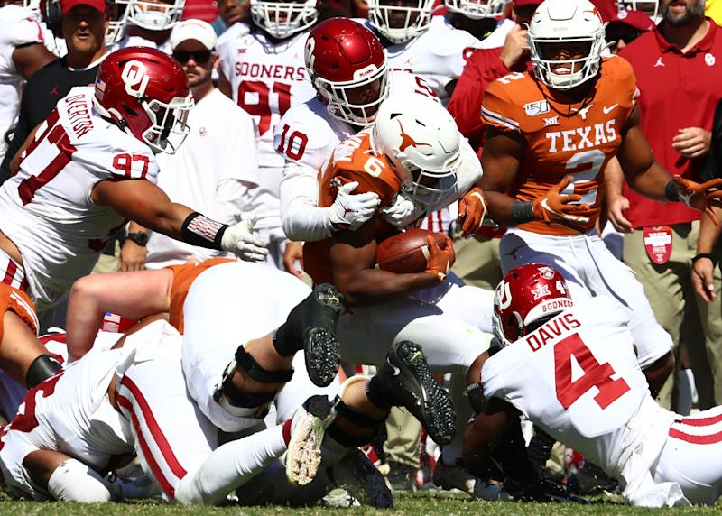 Texas Longhorns receiver Devin Duvernay (6) is tackled by Oklahoma Sooners safety Pat Fields (10) in the third quarter at Cotton Bowl. (USA Today)