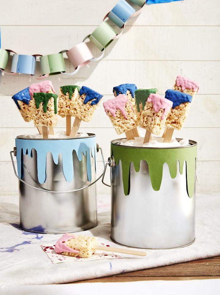 """<p>Set up a painter's paradise to celebrate your young artiste's first birthday. Make garlands from paint decks, whip up a few crispy rice treats to make paint brush lookalikes (shown), and set up a <a href=""""https://www.amazon.com/Crayola-Finger-Toddlers-Painting-Included/dp/B077VX5YH3/ref=asc_df_B077VX5YH3/"""">kid-friendly finger painting</a> station for guests.</p>"""