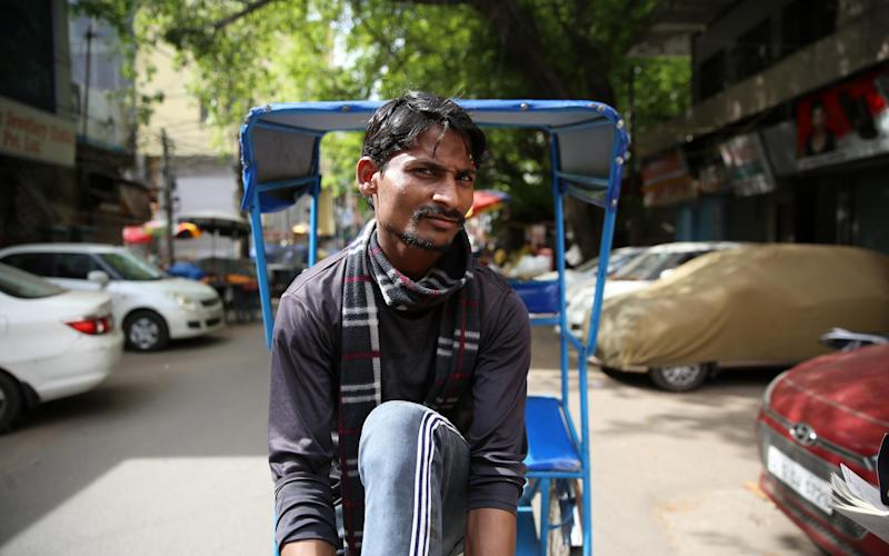 Muhammad Asif, 21, says despite the lockdown he will carry on driving his rickshaw to feed his family - Cheena Kapoor