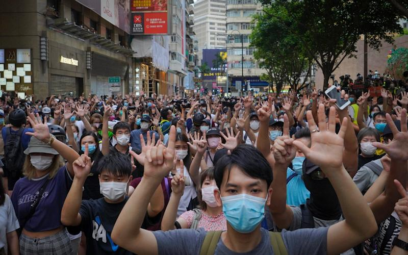 China's new security law has effectively outlawed protest in Hong Kong - AP