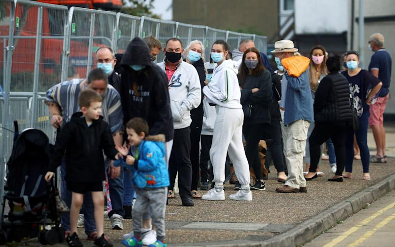 People queue at a coronavirus test centre in Southend-on-Sea, Essex, on Wednesday - REUTERS