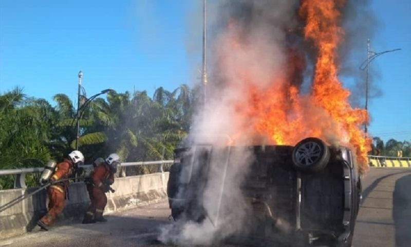 Firefighters at the scene of the accident in Jalan Skudai February 11, 2019. — Via Facebook/Skudai Fire and Rescue Department