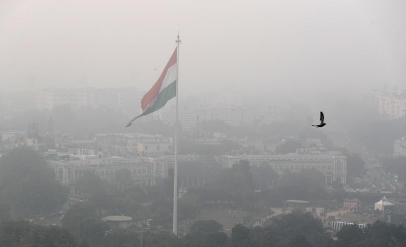 A bird flies past as Delhi's sky line is seen enveloped in smog and dust in New Delhi, India, Nov. 1, 2019. (Photo: Manish Swarup/AP)