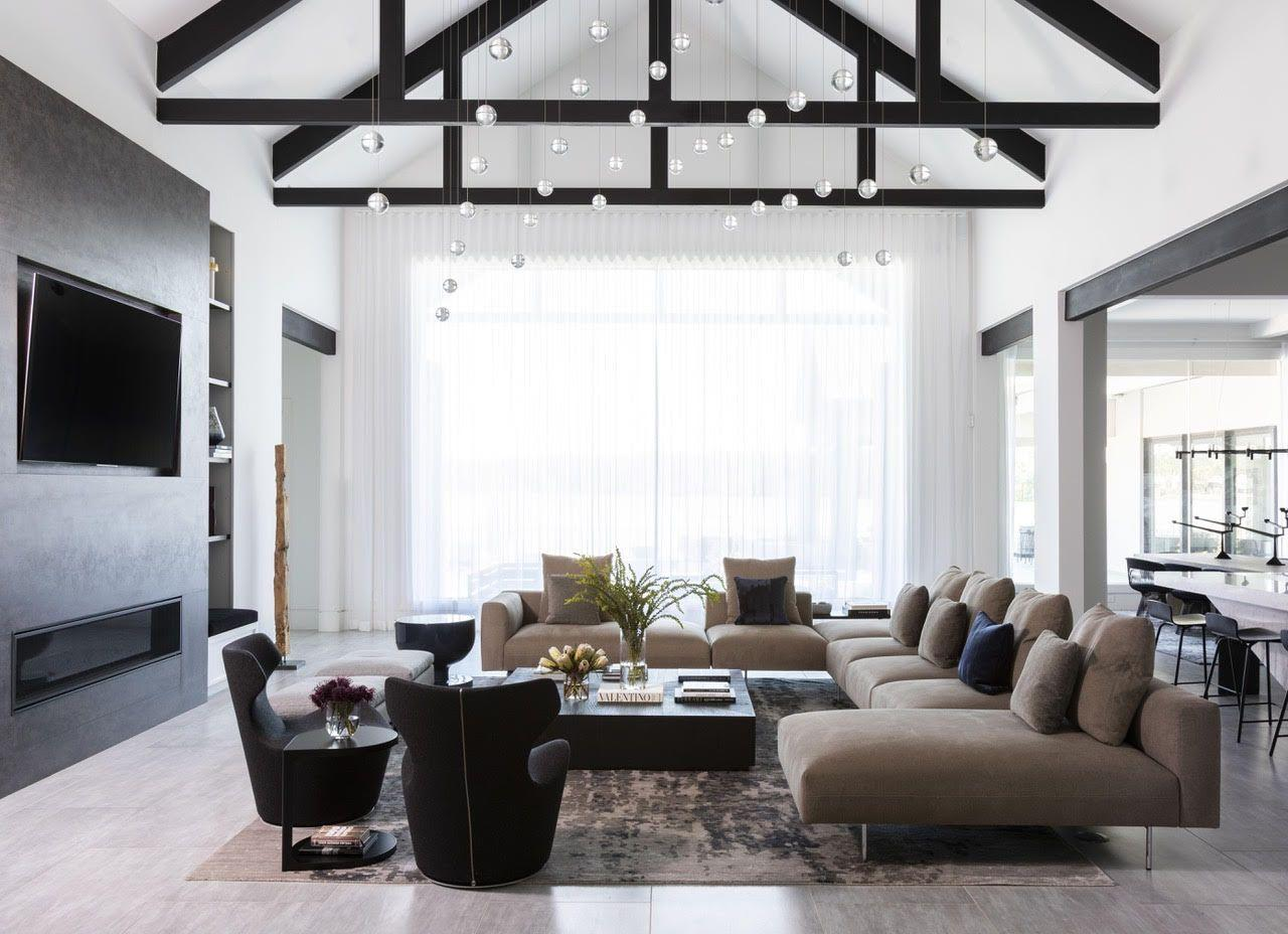 "<p>""Stick with the simple sophistication of natural elements like exposed wood beams and stone accents that evoke a clean and relaxed modern farmhouse interior,"" says Nina Magron of <a href=""https://contourinteriordesign.com/"" target=""_blank"">Contour Interior Design</a>.  ""Introduce accessories that are organic, irregular, or slightly imperfect to add personality and charm.""</p>"