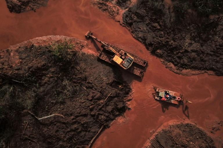 Emergency crews use an amphibious vehicle and heavy machinery in May 2019 to pick through mud and search for bodies, 99 days after the collapse of the Corrego do Feijao Dam in Minas Gerais