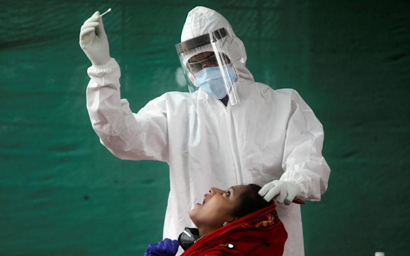India's beleaguered public health system has struggled to slow the spread of the virus - Francis Mascarenhas/Reuters