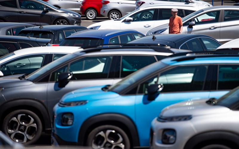 people view cars on the forecourt at Motorpoint showroom in Oldbury, West Midlands: Monday June 1, 2020 - Jacob King/PA