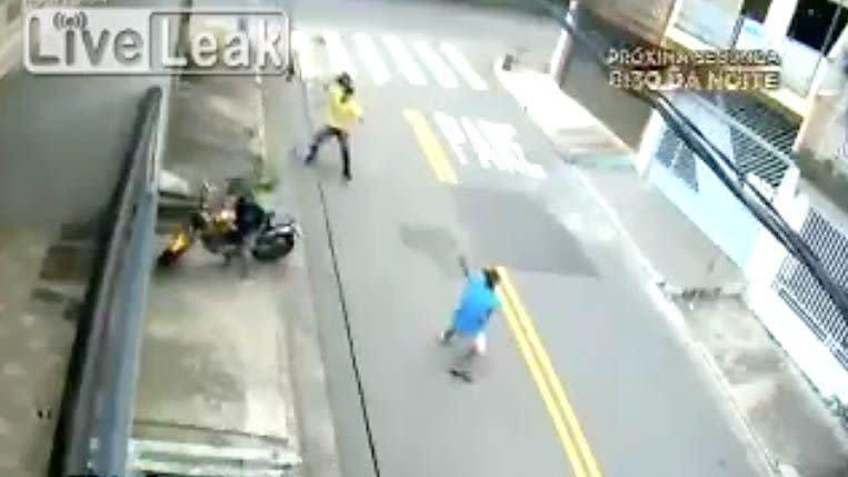 Man uses helmet to fight off gun-toting motorcycle thieves