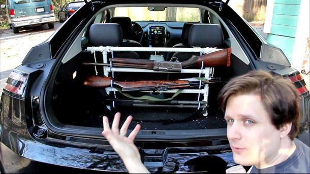 Chevrolet Volt owner shows Newt Gingrich how to put a gun rack in one
