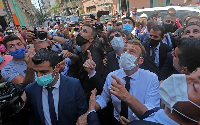 French President Emmanuel Macron toured heavily damaged Beirut neighbourhoods on Thursday - AFP