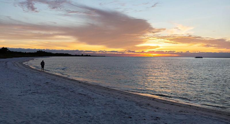 The sunset over the idyllic Fort Myers Beach in Big Carlos Pass, Florida where the dolphin was found.
