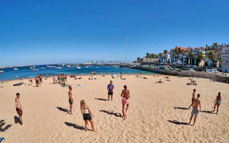 Beachgoers play soccer and keep social distancing in Praia da Ribeira, Portugal - Corbis News