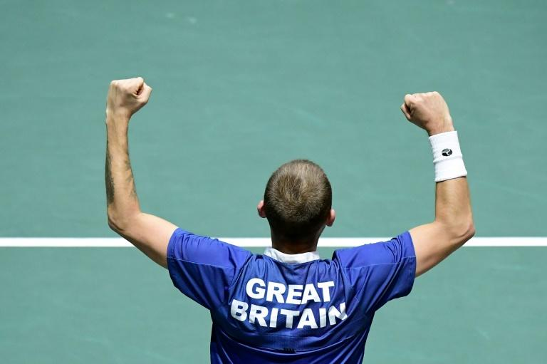 Great Britain's Daniel Evans celebrates after winning his David Cup quarter-final rubber