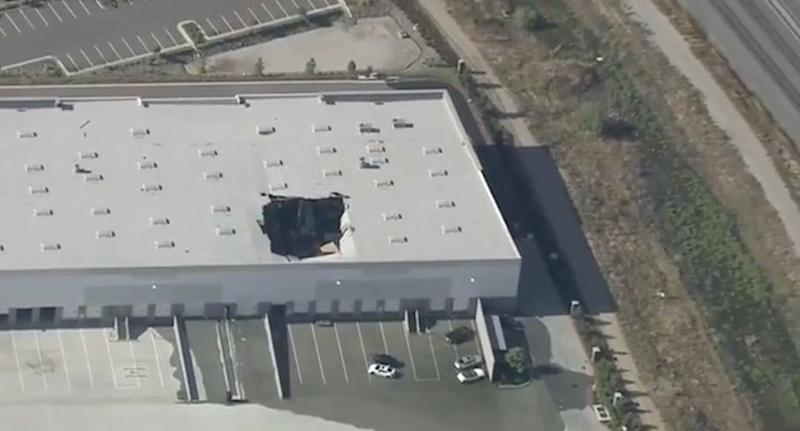 F-16 fighter jet crashes into California building