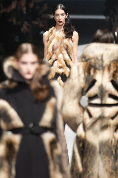 Models wear creations from designers Viktor & Rolf  as part of the Fall-Winter, ready-to-wear 2013 fashion collection, during Paris Fashion week, Saturday, March 3, 2012. (AP Photo/Jacques Brinon)