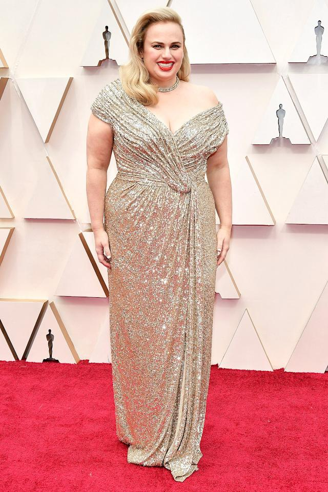 "Underneath her custom gilded sequin Jason Wu gown, the actress wore the <a href=""http://skims.wsktbf.net/c/249354/618913/10056?subId1=PEO%2CStarsinSKIMS%21SeetheCelebsObsessedwithKimKardashian%27sShapewearLine%2Ckaitlynfrey%2CUnc%2CGal%2C7444398%2C201902%2CI&u=https%3A%2F%2Fskims.com%2Fproducts%2Fsculpting-short-above-the-knee-onyx"" target=""_blank"" rel=""nofollow"">SKIMS Sculpting Short</a> to enhance her shape."