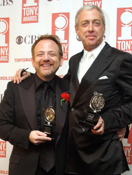 "FILE - In this June 8, 2003 file photo, Marc Shaiman, left, and Scott Wittman pose with their Tony awards for Best Original Score for ""Hairspray"" during the 57th Annual Tony Awards at New York's Radio City Music Hall. Their song, ""Hang the Moon,"" from TV's ""Smash,"" is nominated for an Emmy. The 2013 Primetime Emmy Awards are Sunday, Sept. 22. (AP Photo/Mary Altaffer, File)"