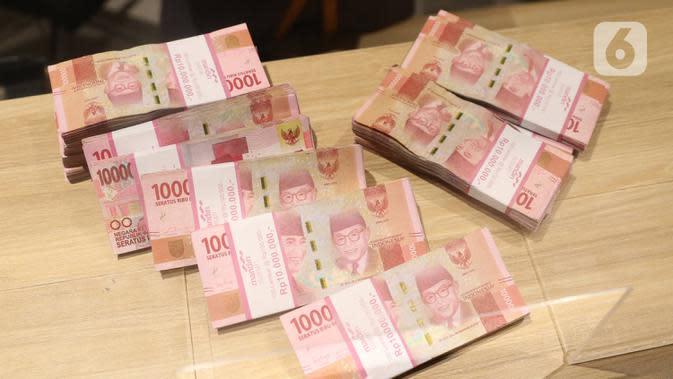 Tumpukan mata uang Rupiah, Jakarta, Kamis (16/7/2020). Bank Indonesia mencatat nilai tukar Rupiah tetap terkendali sesuai dengan fundamental. (Liputan6.com/Angga Yuniar)