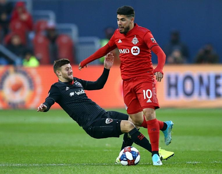 Toronto FC's Alejandro Pozuelo, evading a tackle attempt by DC United's Paul Arriola, has sparked the Canadian MLS squad in the wake of an injury to Jozy Altidore