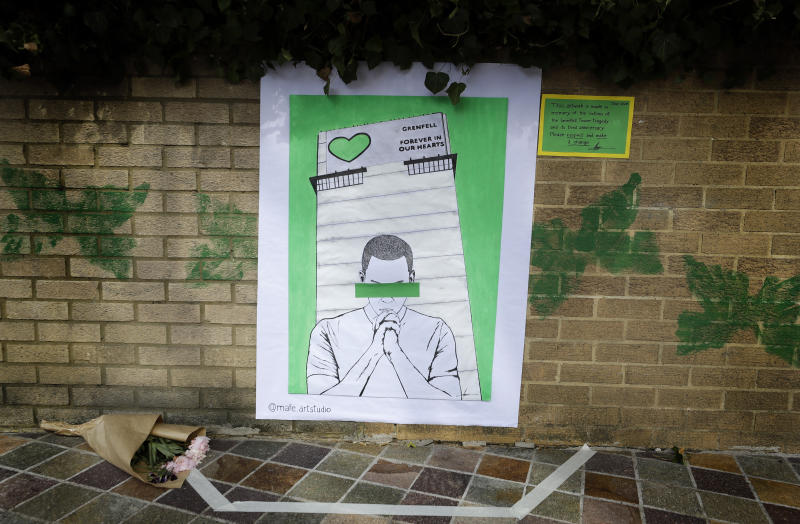 Artwork made in memory of the victims of the Grenfell Tower block fire, near Grenfell Tower, in London, Sunday, June 14, 2020. Britain is marking the third anniversary of the Grenfell Tower fire with a virtual church service to remember the 72 people who died in the blaze. Sunday marks three years since a small kitchen fire in the west London public-housing block turned into the worst domestic blaze in the country since World War II. (AP Photo/Kirsty Wigglesworth)