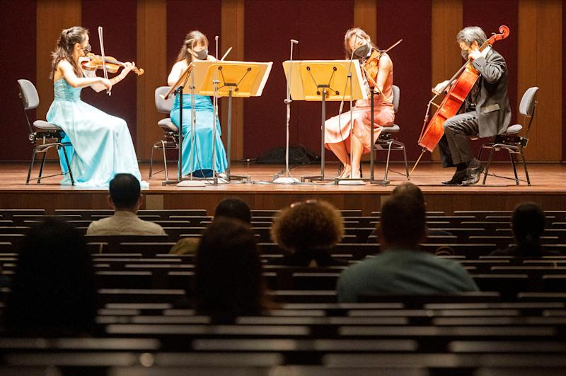 SINGAPORE, Oct. 8, 2020 -- Members of the Singapore Symphony Orchestra perform in the first live concert since the implementation of preventive measures against COVID-19 from April 7, 2020, at the Victoria Concert Hall in Singapore on Oct. 8, 2020. The live concert was attended by 50 people. (Photo by Then Chih Wey/Xinhua via Getty) (Xinhua/Then Chih Wey via Getty Images)
